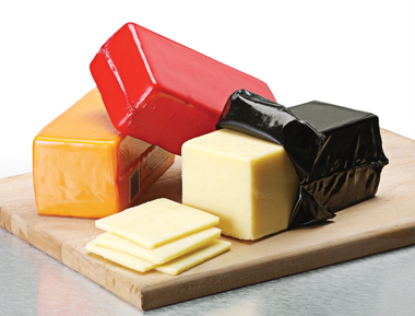 Packaged cheeses using high barrier shrink bags